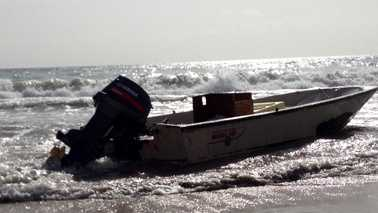 This boat came ashore with several migrants near Jensen Beach on Friday morning, investigators said. (Photo: Chris McGrath/WPBF)