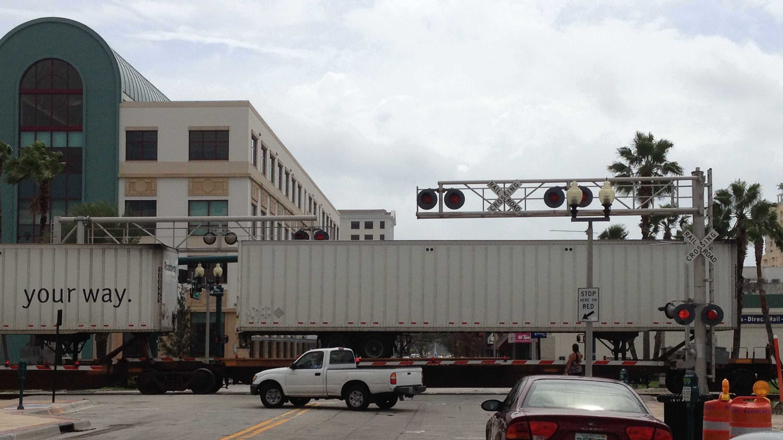 A freight train was stopped on the railroad tracks in downtown West Palm Beach, blocking traffic near the intersection of Clematis Street and Quadrille Street.