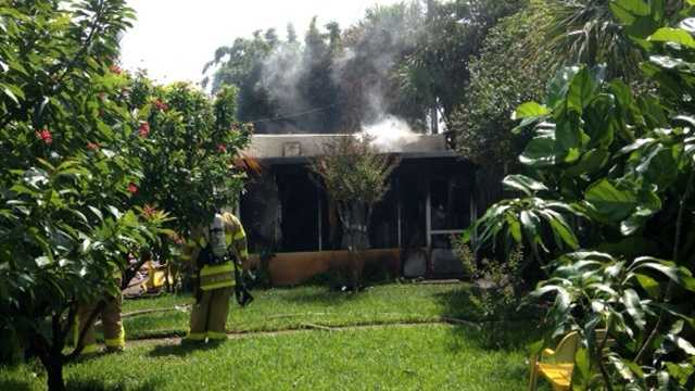 A Hazmat team was called to 59th Street after an explosion left a house ablaze in West Palm Beach on Tuesday. (Photo: Ted White/WPBF)