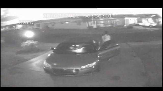 Surveillance video shows two teens burglarizing a convertible in Pompano Beach.