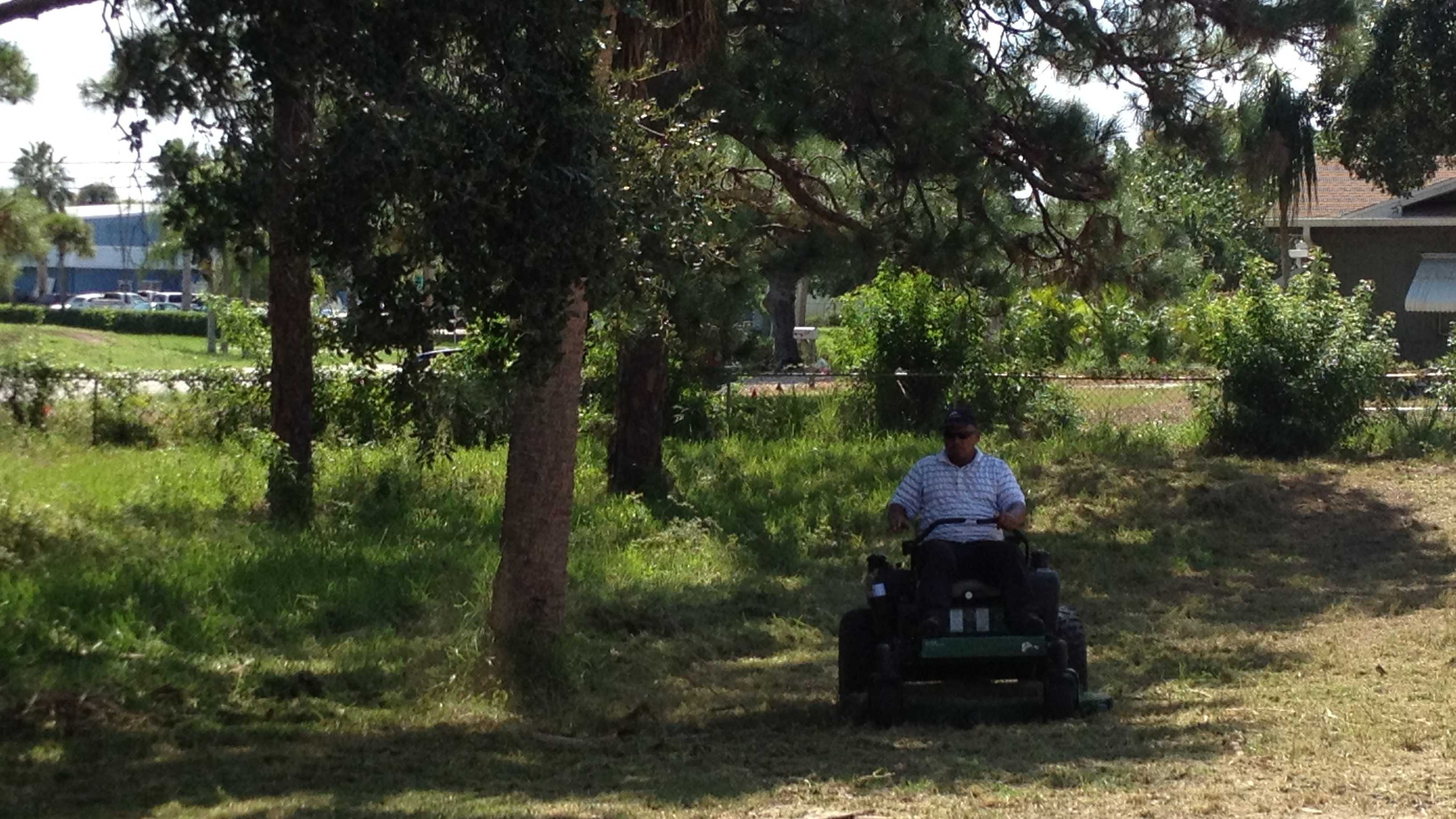 Gary McKinnond is mowing an overgrown cemetery in Vero Beach.