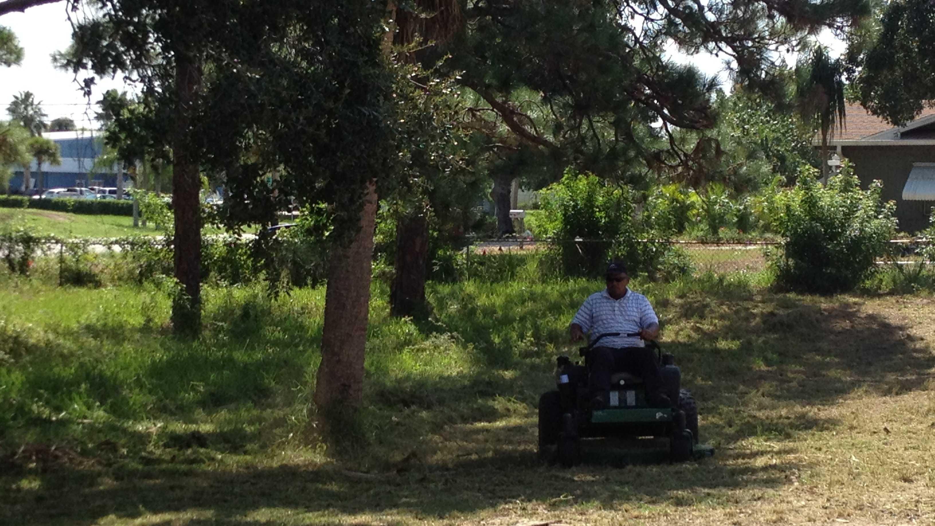 Gary McKinnond is mowing an overgrown cemetery in Vero Beach.