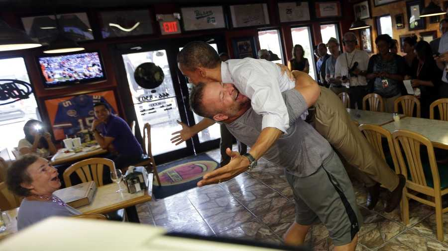 Restaurant owner Scott Van Duzer was so excited about President Barack Obama visiting his establishment that he lifted the commander-in-chief off his feet in abear hug.