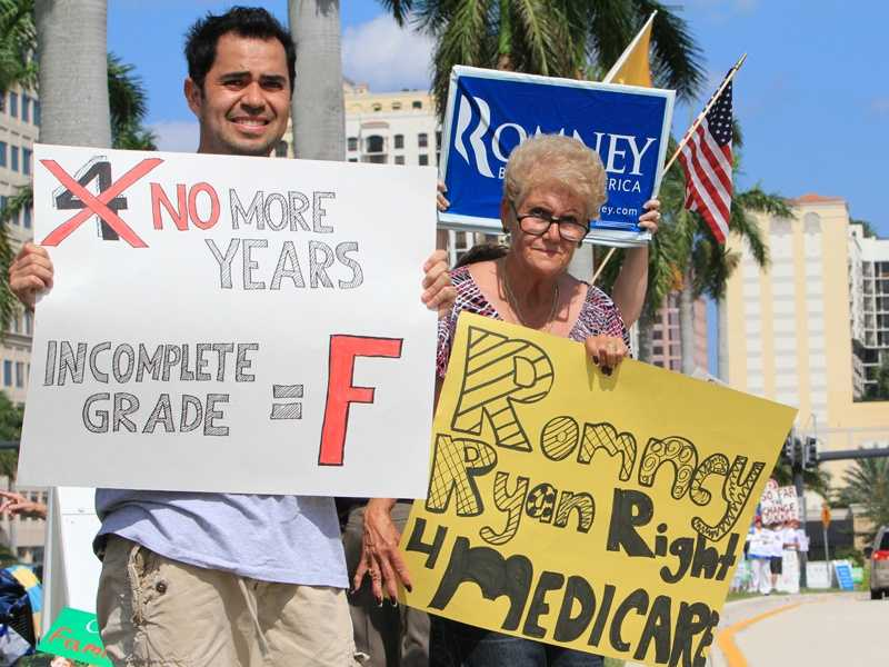 Protesters were out in full force along Okeechobee Boulevard on Sunday, awaiting President Barack Obama's visit to downtown West Palm Beach. (All photos taken by John P. Wise)