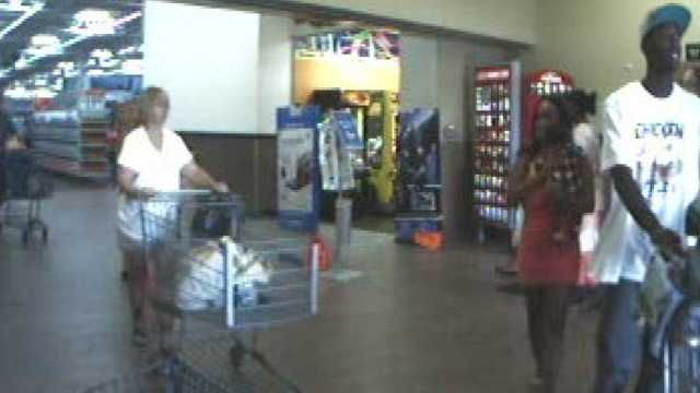 Police are trying to identify a man and woman (right) accused of using stolen credit cards on the Treasure Coast.