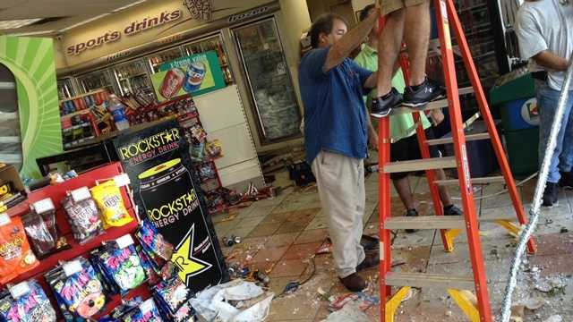 A gas station window was shattered, but the store remained open for business. The cause of the crash wasn't immediately known.