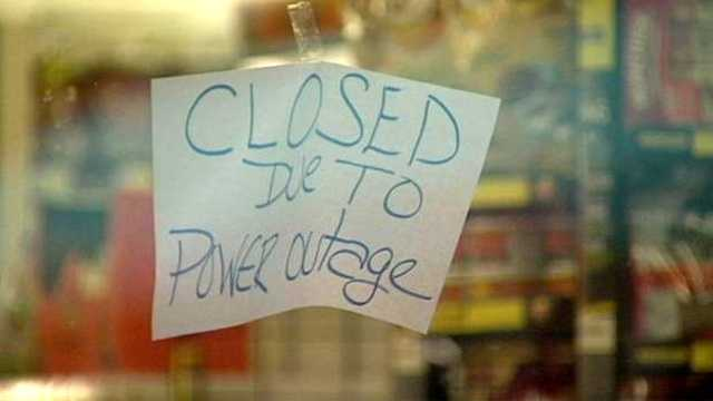 Signs like this one were commonplace around Lake Worth after a power outage Wednesday night.