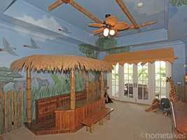 You can almost hear the elephants yourself in this amazing safari themed room.
