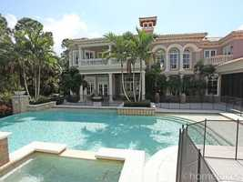Fencing around the huge pool and Jacuzzi provides safety, without compromising the huge outdoor space.