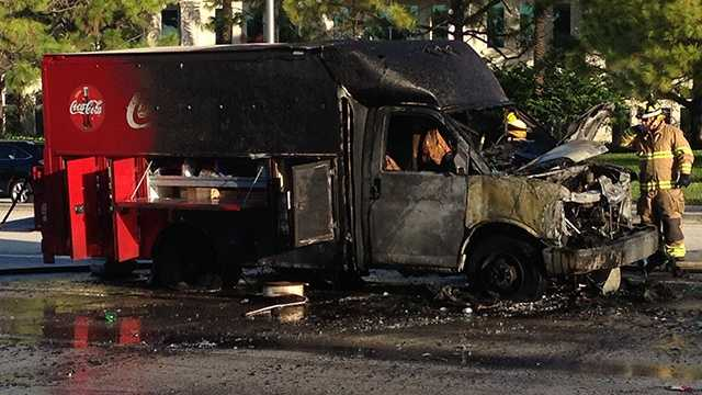This Coca-Cola truck caught fire on PGA Boulevard, complicating the Tuesday morning drive for many commuters. (Photo: John P. Wise/WPBF)