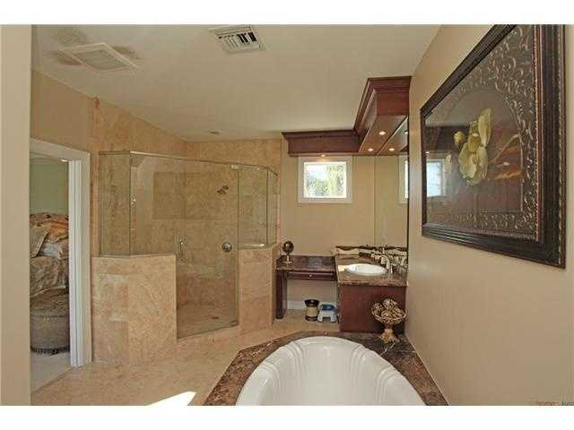 This bathrooms offers both luxuries of a large shower and bath so residents don't have to make compromises.