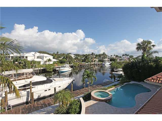 Views from the balcony over look the pool jacuzzi and your yacht's parking space.