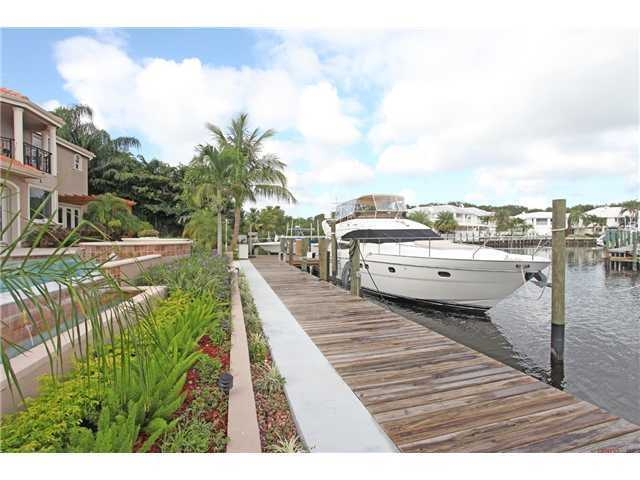Another dock view, so you can take in the pools proximity to the dock and beautiful landscaping.