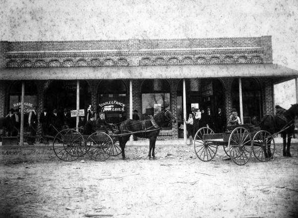 High Springs (Alachua County): The town was named this because a spring was located atop a hill within the town, but the spring no longer exists.The picture is of a shop front in High Springs in 1910.