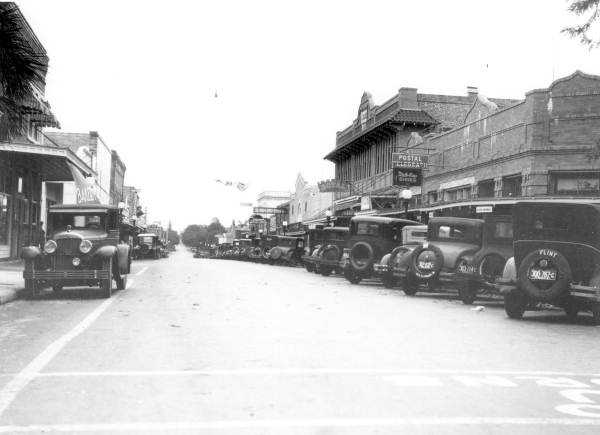 """Tarpon Springs (Pinellas County): The name is said to have come from a remark from Mrs. Ormond Boyer, who exclaimed """"See that tarpon spring"""" while watching fish leap out the water. Note, however, that the fish were not tarpon, but mullet.This picture is from 1927 of the downtown Tarpon Springs area."""