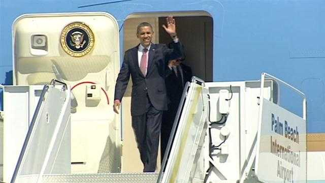 President Barack Obama arrives at Palm Beach International Airport hours before Monday night's final presidential debate.