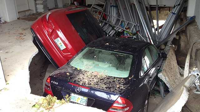 A garage collapsed on these cars at Bathtub Reef Beach on Friday morning. (Photo: Cathleen O'Toole/WPBF)