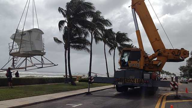 A crane removes a lifeguard stand on Palm Beach on Friday. (Photo: Chris McGrath/WPBF)