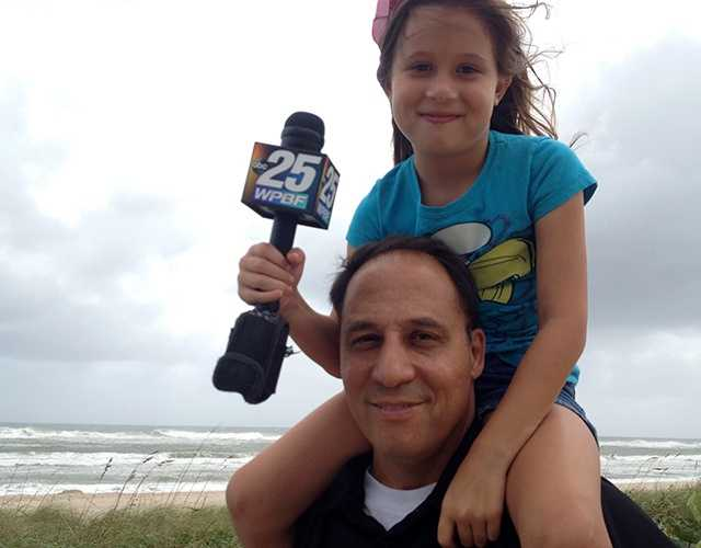 West Palm Beach resident Doug Mollo and his daughter Hannah enjoy a Friday morning at the beach. (Photo: Chris McGrath/WPBF)
