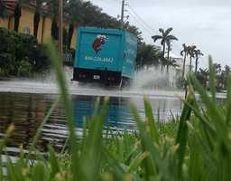 A tuna truck drives through high water in Manalapan on Friday. (Photo: Chris McGrath/WPBF)