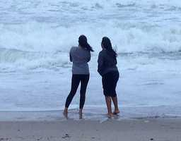 Early morning beachgoers take in the sights in Lake Worth. (Photo: Chris McGrath/WPBF)