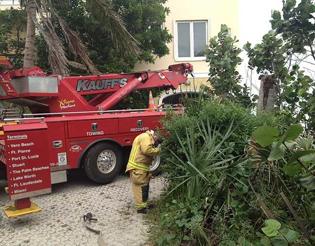 Here's the tow truck charged with the difficult task of pulling the Benzes out of the garage near Bathtub Reef Beach. (Photo: Cathleen O'Toole/WPBF)