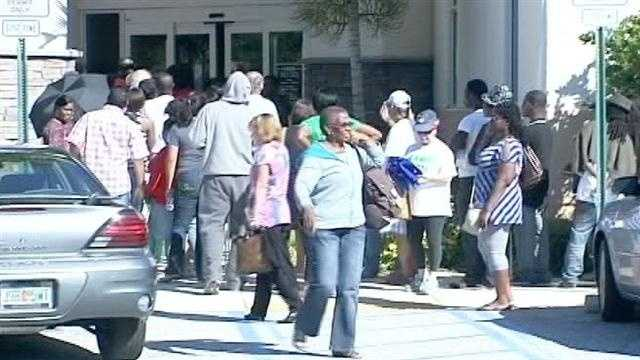 People wait four hours in a long line to vote early in Lantana.
