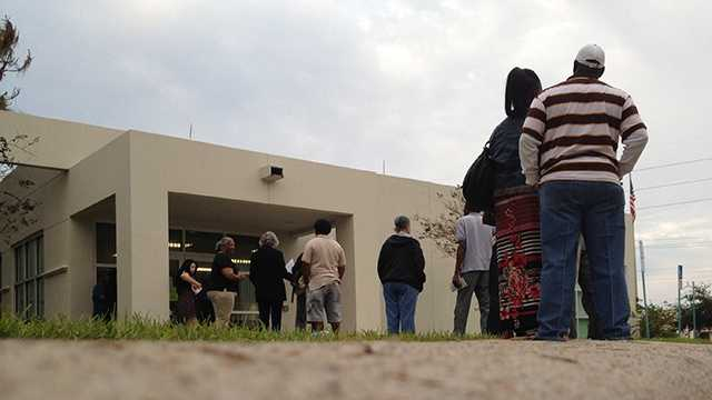 Early voters stand in line Monday morning, hoping to cast their ballots before Election Day. (Photo: Chris McGrath/WPBF)