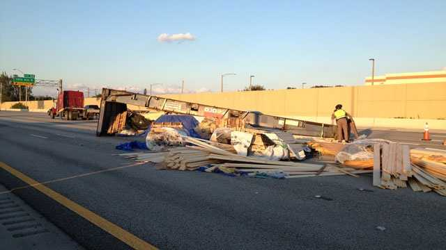 A load of wood blocks traffic in the northbound lanes of Interstate 95 in Lake Worth.