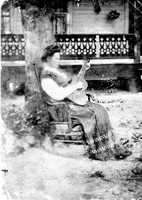 Martha Chamberlin plays guitar in the 1800s near Micanopy.