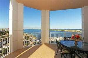 Every room of this 2-story apartment has spectacular Ocean, Intracoastal and/or western views,
