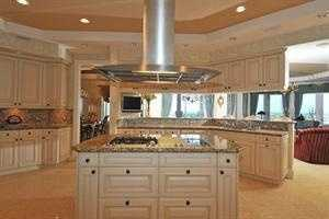 Marble floors throughout the home and this kitchen which features a marble-topped island.