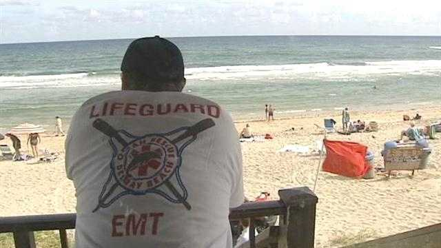 Lifeguards keep a close eye on swimmers in Delray Beach because of rip currents.