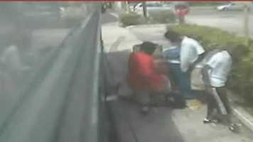 A South Florida teen was dragged off a school bus and beaten by three others over a cellphone.