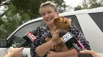 Patricia Walker is all smiles after adopting three-legged Autumn Nov. 14.