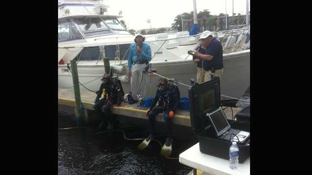 Sheriff's office divers on Nov. 14 search for the body of a man who was found near his house boat at Club Med.