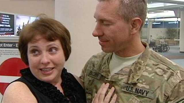 A Navy sailor and his cancer-stricken fiance had a tearful reunion at Palm Beach International Airport on Wednesday night.