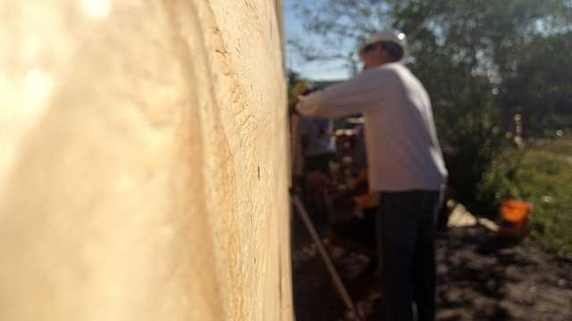 Habitat For Humanity is getting some help from local firefighters to meet a February deadline to build 36 homes. (Photo: Chris McGrath/WPBF)