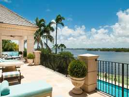 Outdoor deck offers beautiful views of the waterway and pool.