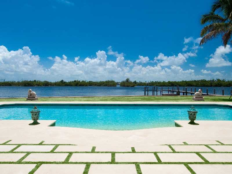 Beautiful pool is moments away from the waterway.