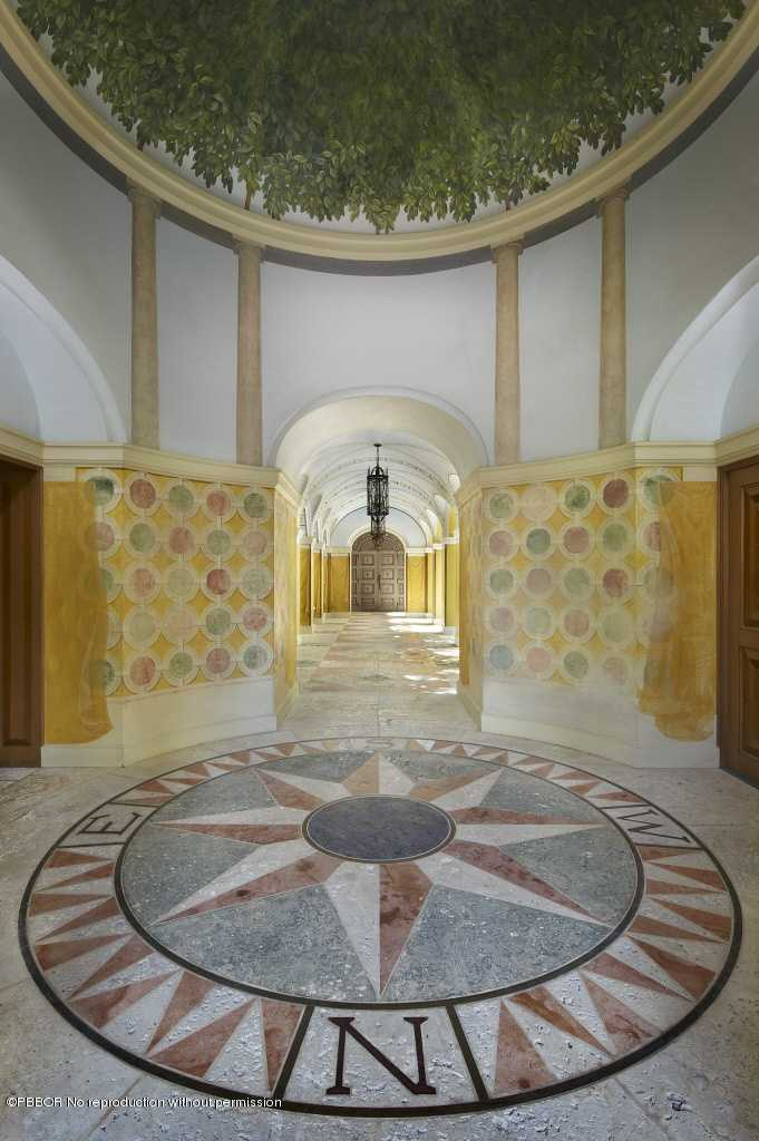 Ceiling mural gives a Mediterranean appeal to this grand entrance way