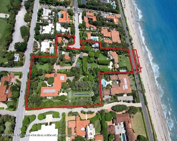 Aerial view with outlines of the property's lot and it's proximity to the ocean. For more information on this estate contact realtor.com