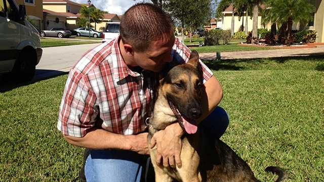 FHP Trooper Bobby Boody meets his new dog, Tony, after Drake died following a violent break-in at Boody's home last month.