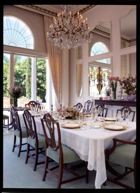 Formal dining area features views of the pool and stands out with this beautiful glass chandelier.