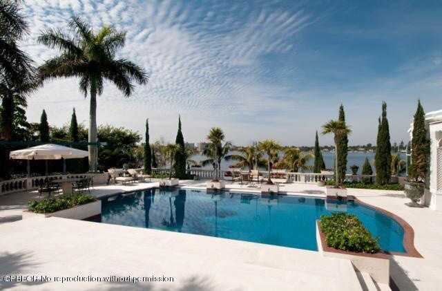 Beautifully design patio area surrounds the pool, which is also steps from the ocean and dock.