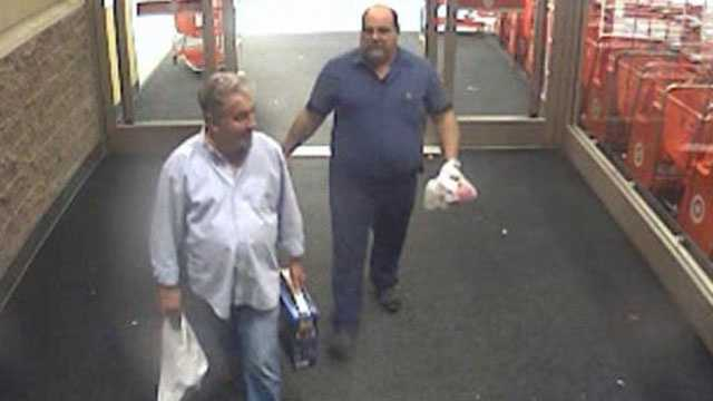 Detectives say these men made thousands of dollars' worth of fraudulent charges on another man's American Express card.