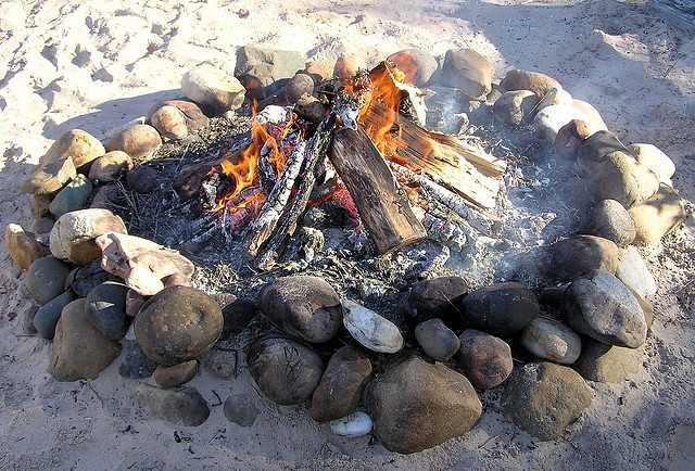 Build a fire on the beach. (Photo: normanack/flickr)