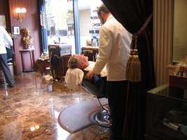 Get a hot shave at a barber shop. (Photo: uberculture/flickr)