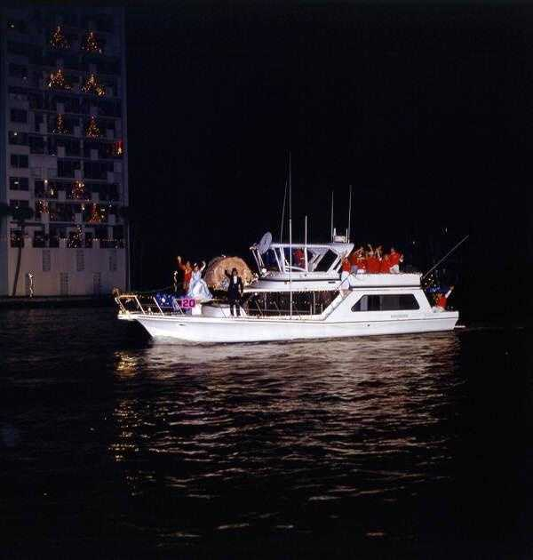 1993: Christmas Boat Parade participants wave to the crowd in Ft. Lauderdale.