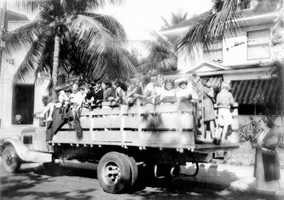 1934: A group of children caroling through the streets of Miami.